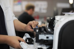 Professional Printer Repair for your Business Equipment - Photocopier Repairs Sheffield - People Hands Opening Checking Printer in Office