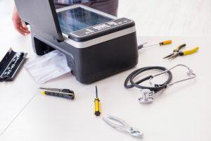 Professional Printer Repair for your Business Equipment - Photocopier Repairs Sheffield - Repairman repairing broken color printer